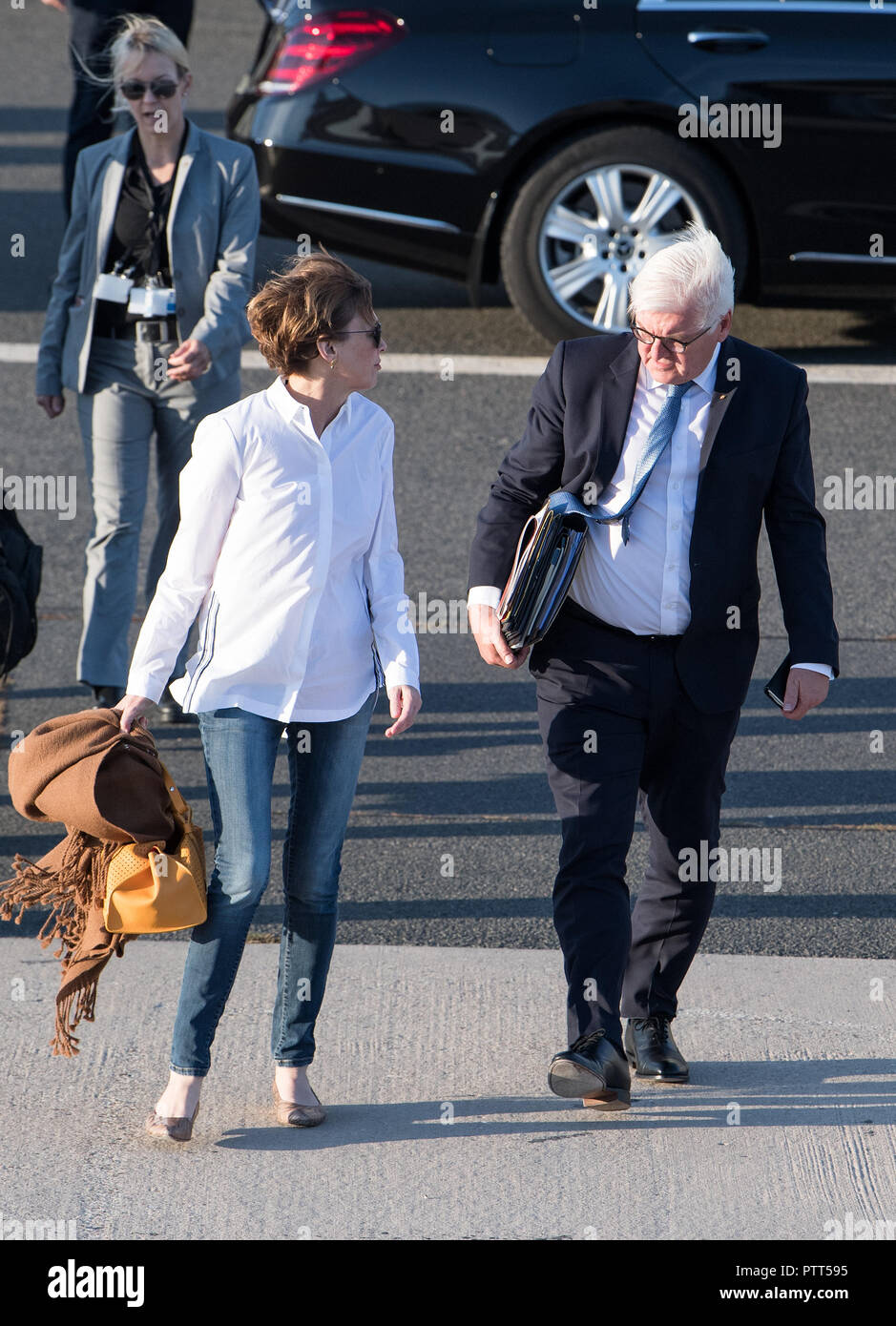 10 October 2018, Berlin: 10 October 2018, Germany, Berlin: President Frank-Walter Steinmeier and his wife Elke Buedenbender board a plane at the military section of Tegel Airport to fly to Athens (Greece). President Steinmeier and his wife start a three-day state visit to Greece. Photo: Bernd von Jutrczenka/dpa Stock Photo