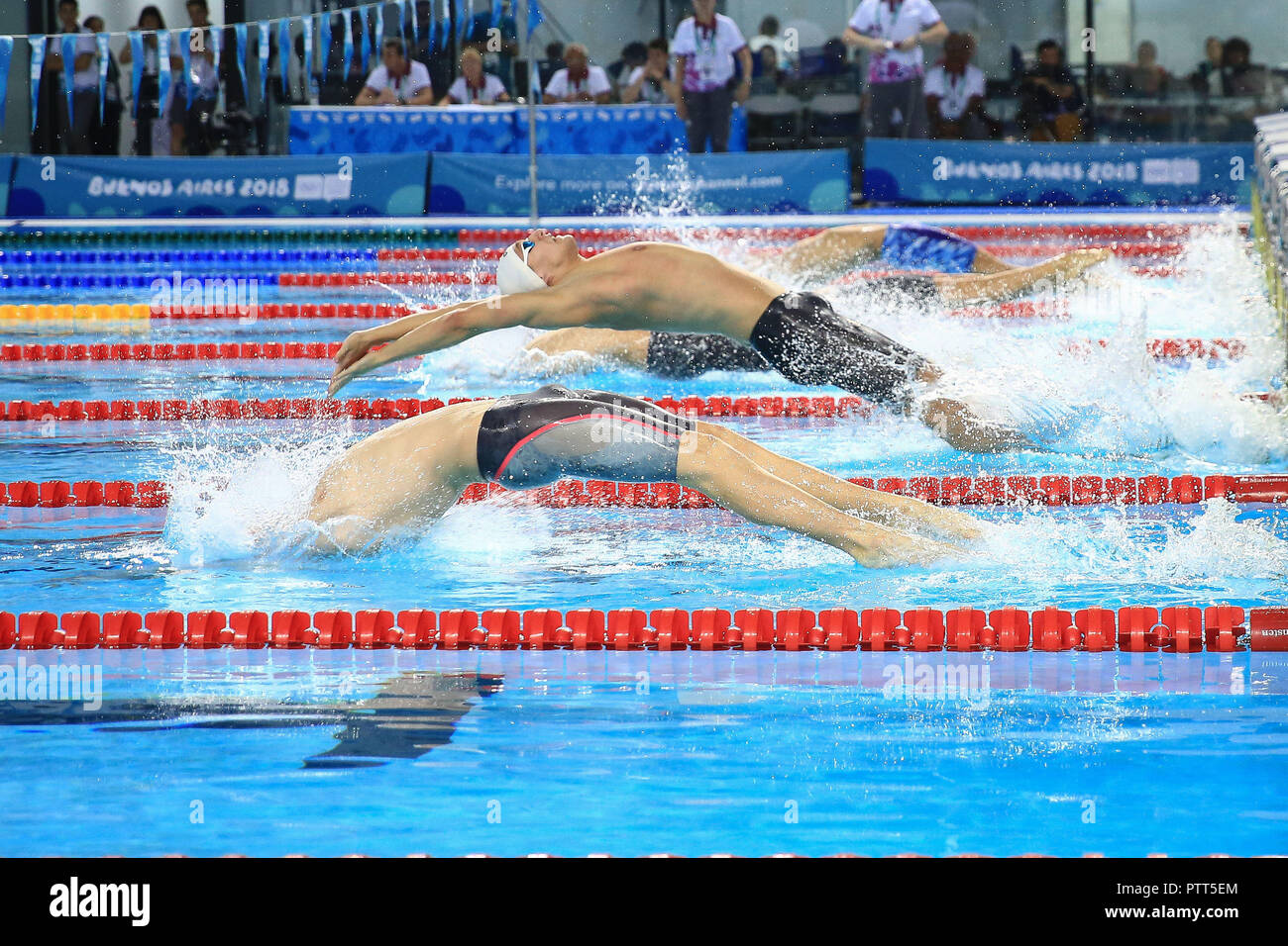 Swimmers compete in a Swimming Men's Team Relay race at the Natatorium during the fourth day of competitions of the Youth Olympic Games, in Buenos Aires, Argentina, 10 October 2018. EFE/Juan Ignacio Roncoroni - Stock Image