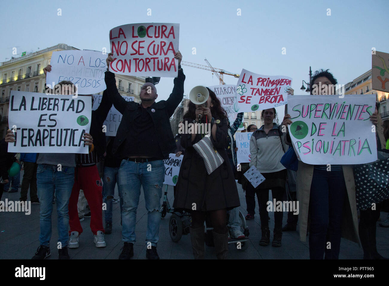 Madrid, Spain. 10th Oct, 2018. Protesters are seen holding posters while shouting during the protest.Hundreds of people have protested from Atocha to Puerta Del Sol against the labels that society puts on them on the International Mental Health Day where the Spanish public health system has demanded for an improvement in the matters of Mental Health, the public health system has also criticized the budget cuts in the Mental Health. Credit: Lito Lizana/SOPA Images/ZUMA Wire/Alamy Live News - Stock Image