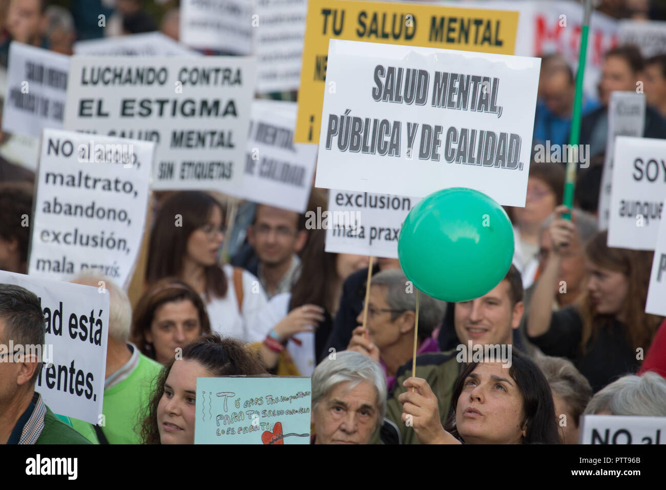Madrid, Spain. 10th Oct, 2018. Protesters are seen holding posters during the protest.Hundreds of people have protested from Atocha to Puerta Del Sol against the labels that society puts on them on the International Mental Health Day where the Spanish public health system has demanded for an improvement in the matters of Mental Health, the public health system has also criticized the budget cuts in the Mental Health. Credit: Lito Lizana/SOPA Images/ZUMA Wire/Alamy Live News - Stock Image