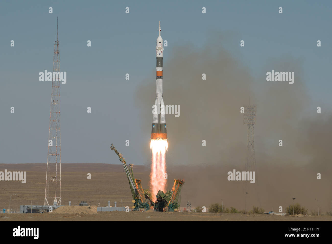 Baikonur, Kazakhstan. 11th October, 2018. The Russian Soyuz Rocket carrying Expedition 57 crew members cosmonaut Alexey Ovchinin and Nick Hague launches from the Baikonur Cosmodrome October 11, 2018 in Baikonur, Kazakhstan. Shortly after lift off the rocket malfunctioned en route to the International Space Station and aborted forcing an emergency landing in Kazakhstan. The crew members have been picked up by search and rescue and are reportedly in good condition. Credit: Planetpix/Alamy Live News - Stock Image