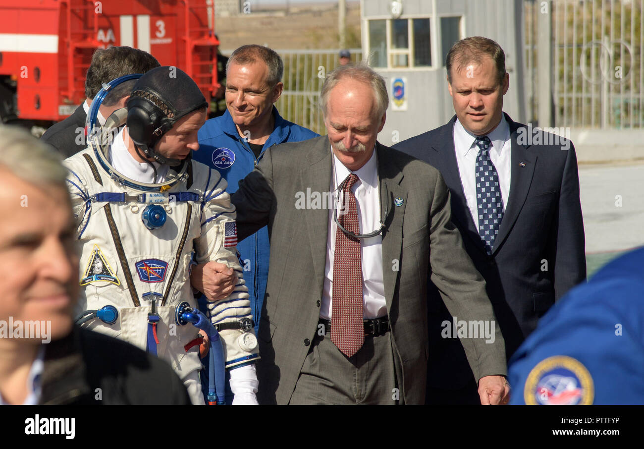Baikonur, Kazakhstan. 11th October, 2018. Expedition 57 Flight Engineer Nick Hague of NASA, walks with NASA Associate Administrator for the Human Exploration and Operations Directorate William Gerstenmaier, center, and NASA Administrator Jim Bridenstine, right, prior to boarding the Soyuz MS-10 spacecraft for launch from the Baikonur Cosmodrome October 11, 2018 in Baikonur, Kazakhstan. Shortly after lift off the rocket malfunctioned en route to the International Space Station and aborted forcing an emergency landing in Kazakhstan. Credit: Planetpix/Alamy Live News - Stock Image