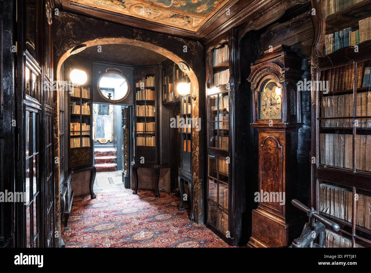 Oak gallery with bookcases and tapestery ceilings on upper floors of Hauteville House - Stock Photo