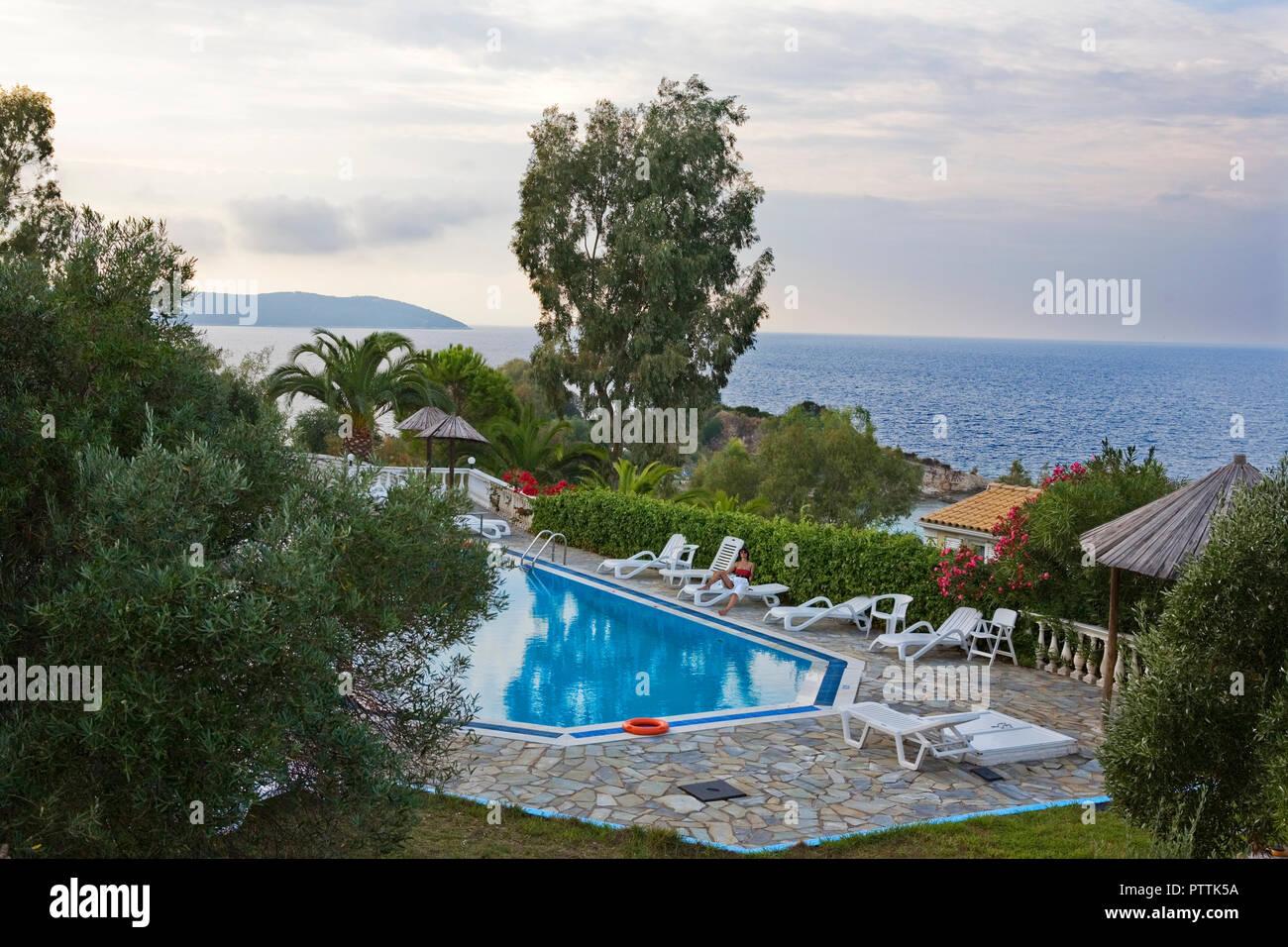 Villa pool at Bataria Beach, Kassiopi, Corfu, Greece - Stock Image
