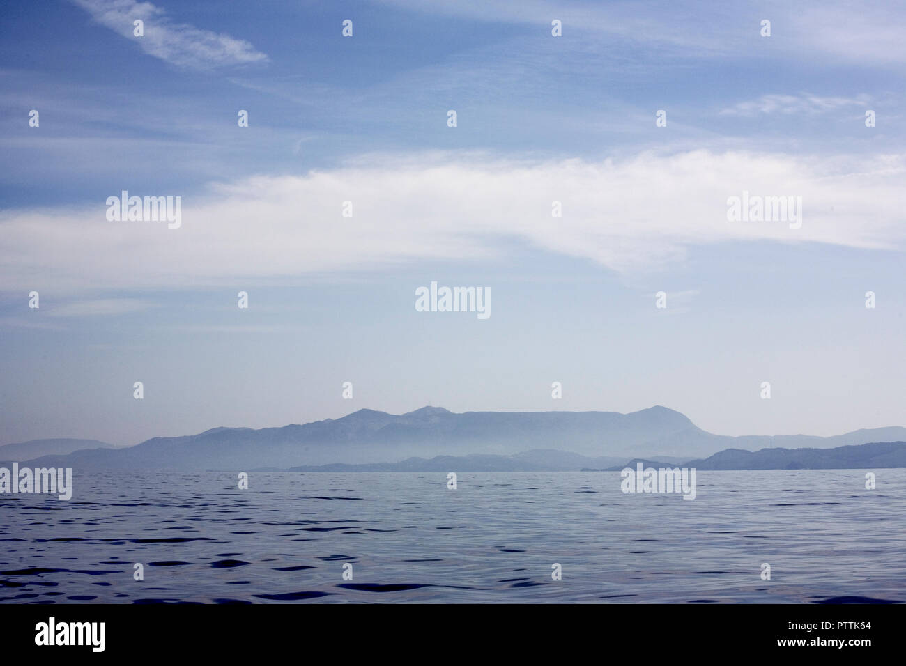 The mountains of Albania seen from on board a yacht off the North coast of Corfu - Stock Image