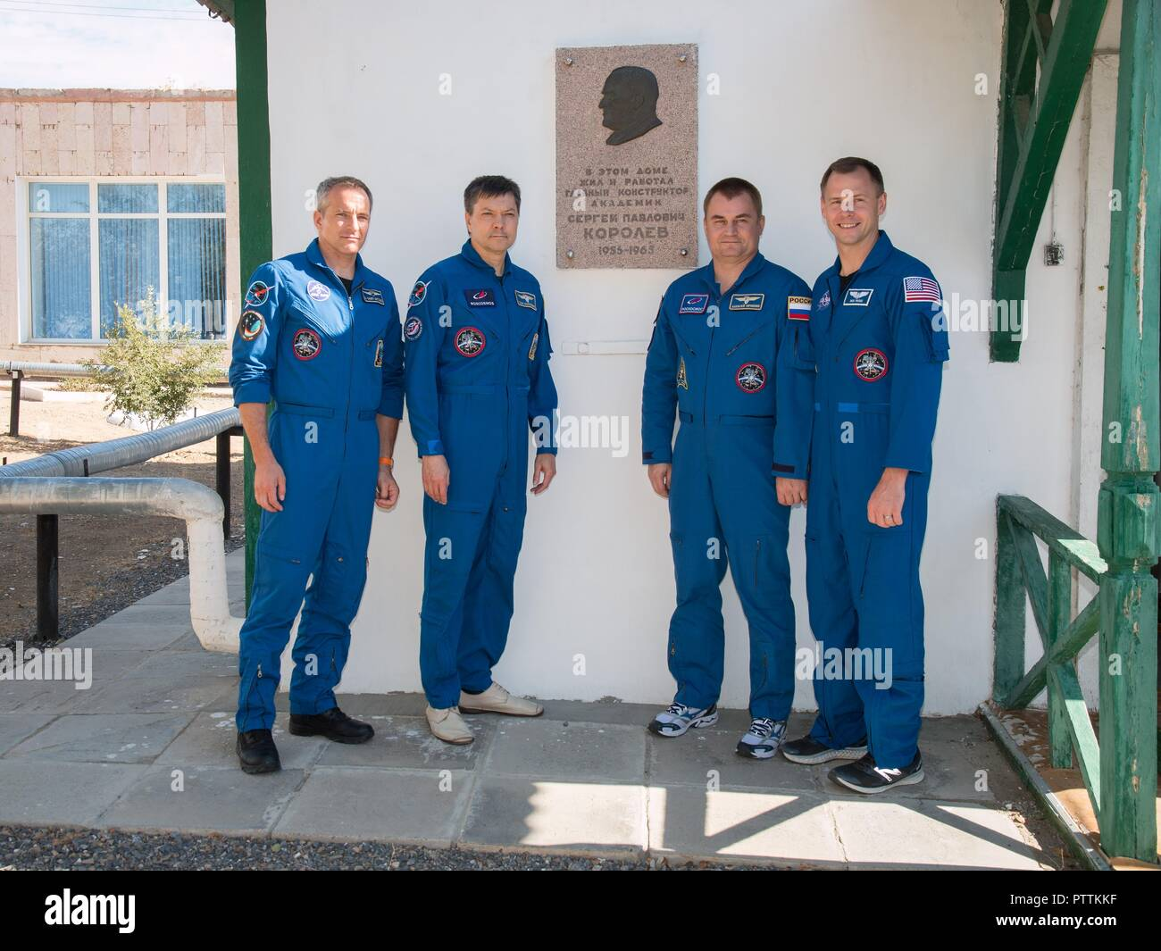 Expedition 57 prime and backup crew pose in front of the cottage where the Russian space icon and Sergei Korolev slept on the night before Yuri Gagarin launched becoming the first human in space at the Baikonur Cosmodrome October 6, 2018 in Baikonur, Kazakhstan.  From left to right are backup crew David Saint-Jacques of the Canadian Space Agency and Oleg Kononenko of Roscosmos, and prime crew Alexey Ovchinin of Roscosmos and Nick Hague of NASA. - Stock Image
