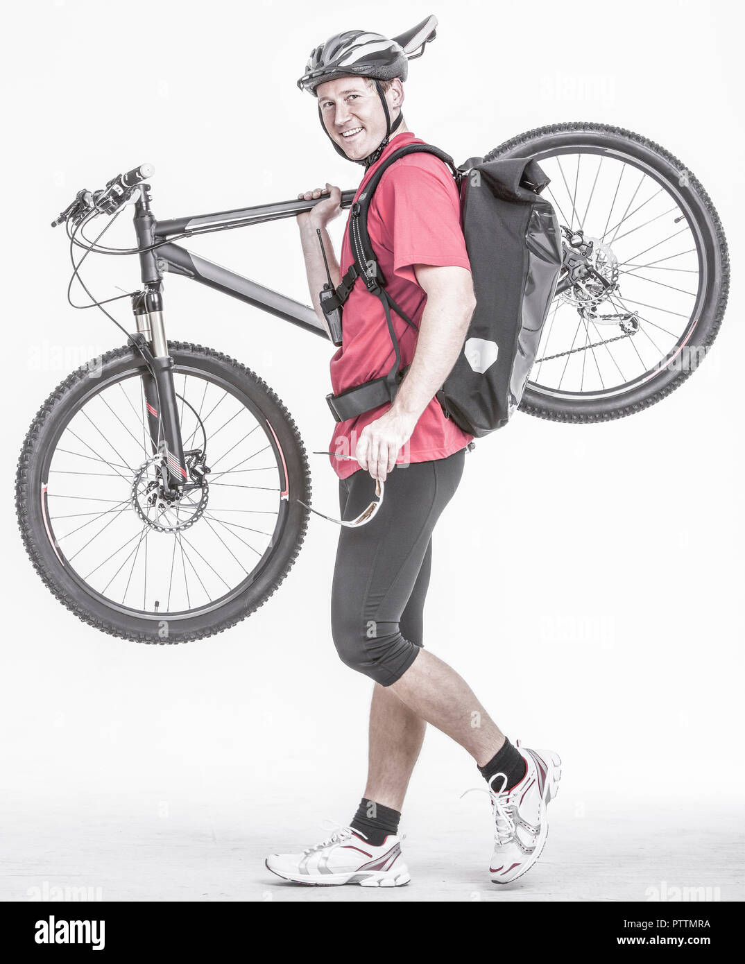 Fahrradkurier traegt sein Rennrad (model-released) Stock Photo