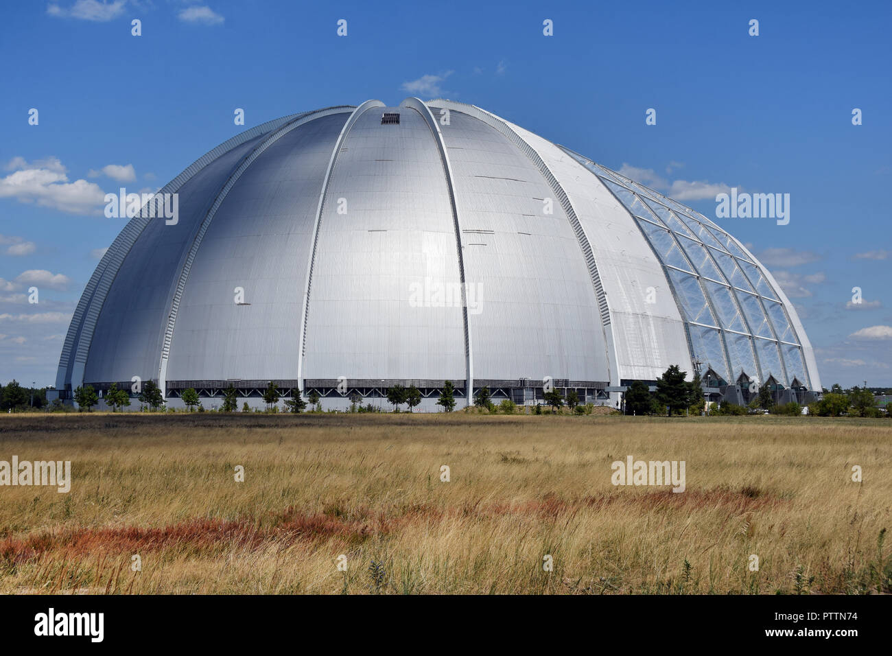 The Tropical Island park installed on the soviet air base runway in Brand, former East Germany. The main part of the park is inside an airship hangar. - Stock Image