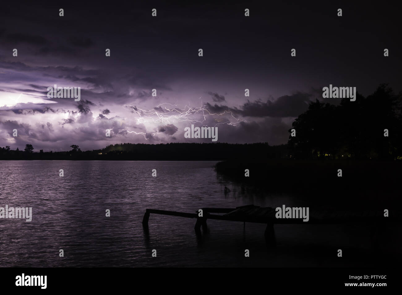 Thunderstorm over a quiet lake Stock Photo