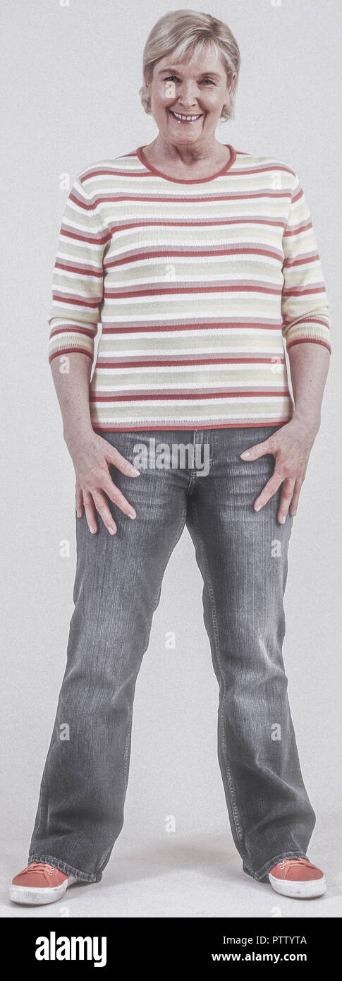 Seniorin in Jeans und Pulli (model-released) Stock Photo