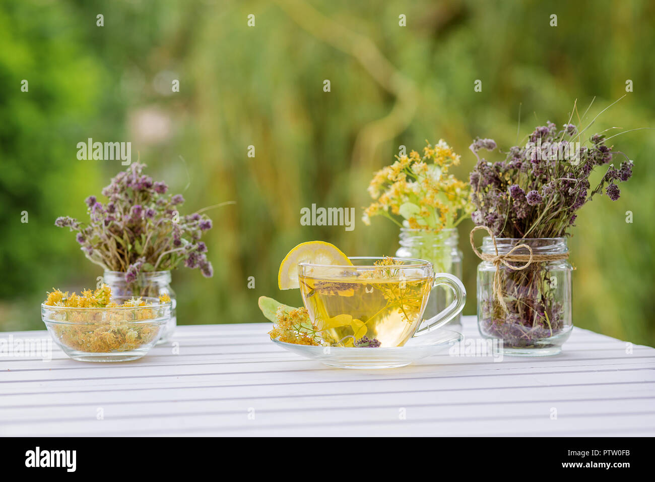 Linden inflorescences, herbal tea, view from high angle, space for a text. Stock Photo