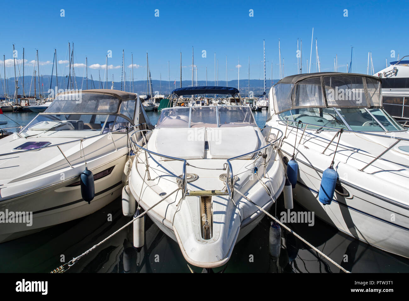 Motorboats, sailing boats and yachts moored in the marina at Yvoire along Lake Geneva / lac Léman, Haute-Savoie, France - Stock Image