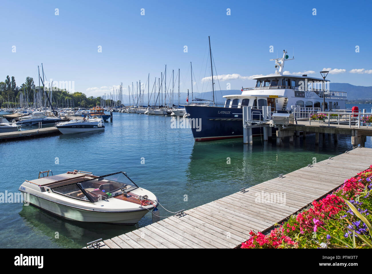 CGN passenger ferry boat Lavaux and sailing boats in the marina at Yvoire along Lake Geneva / lac Léman, Haute-Savoie, France - Stock Image