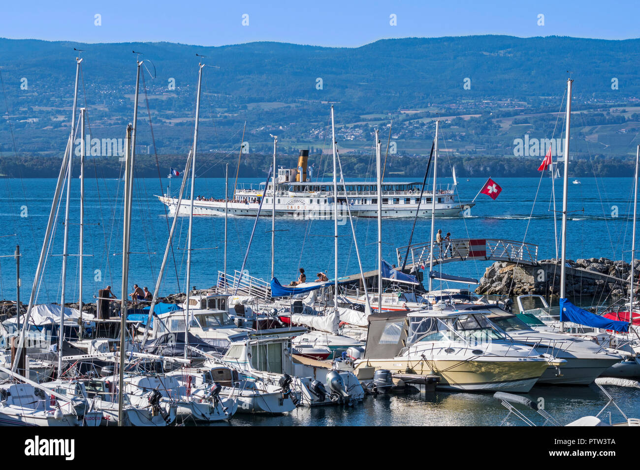 Swiss historic Belle Epoque paddle steamboat Savoie and sailing boats in the marina at Yvoire along Lake Geneva / lac Léman, Haute-Savoie, France - Stock Image