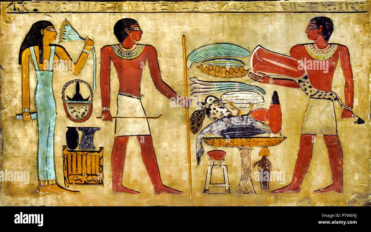 Grave relief of the Cheti Middle Kingdom Early 12th Dynasty, circa 1980 BC Chr. . Egypt. (m The relief shows Cheti and his wife in front of a lavishly furnished offering table. A son of the couple brings another beef leg. ) Stock Photo