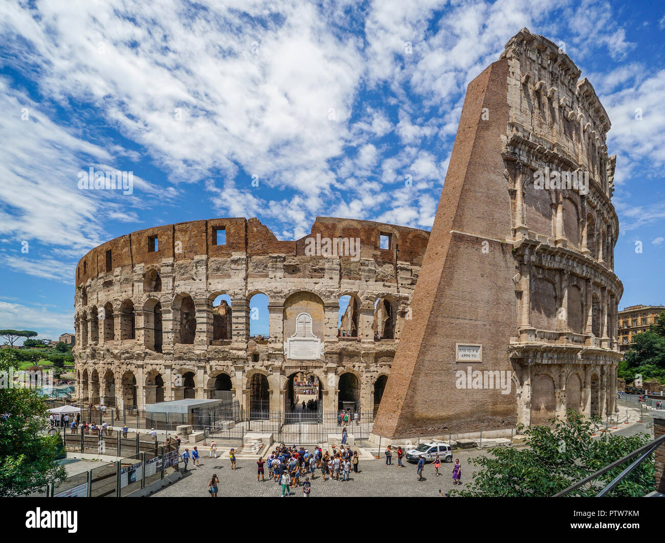 a massive brick spur supports the outer ring of the Colosseum, the largest Roman amphitheatre ever built and one of Rome's most iconic tourist attract - Stock Image