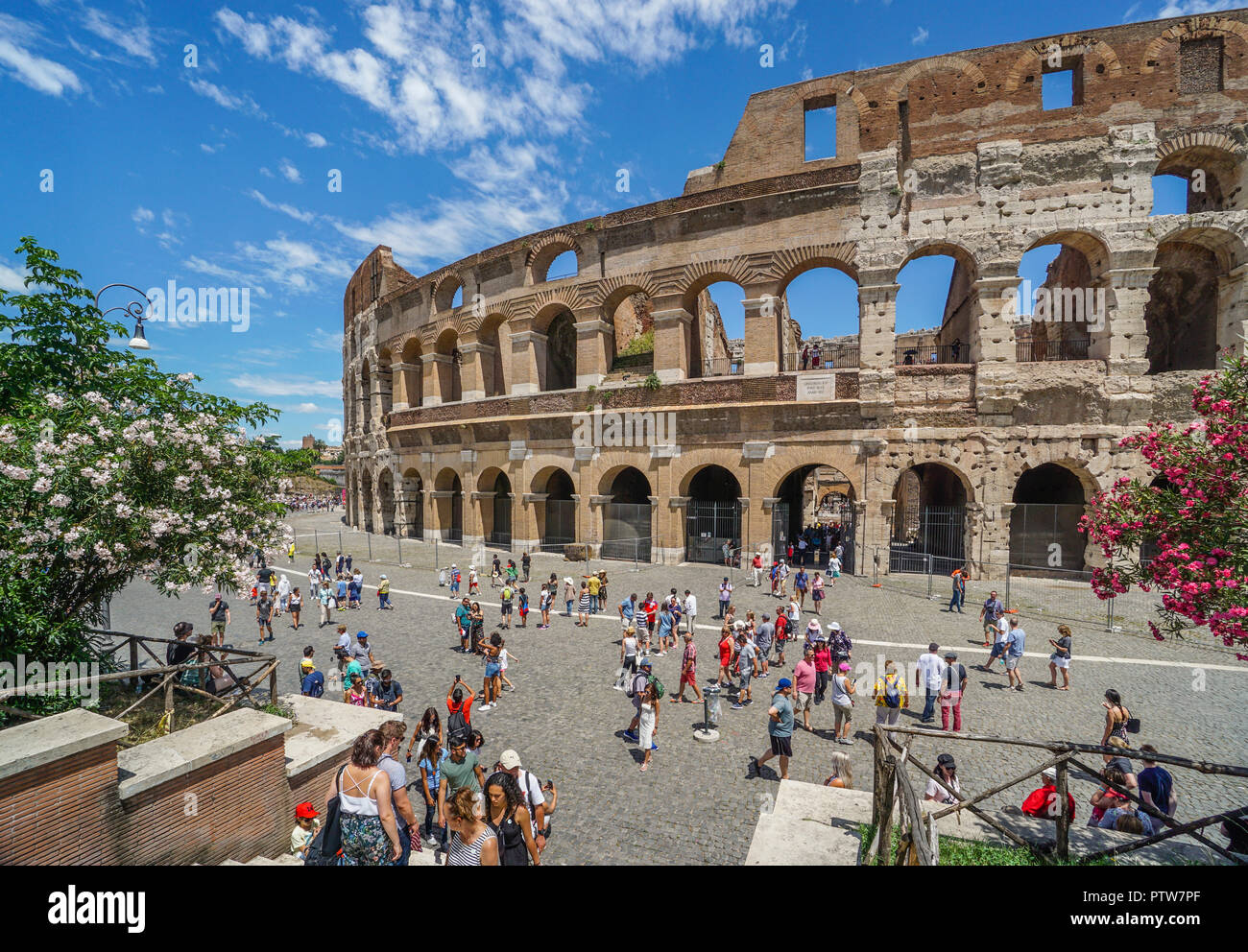 the monumental facade of the Colosseum, the largest Roman amphitheatre ever built and one of Rome's most iconic tourist attractions - Stock Image