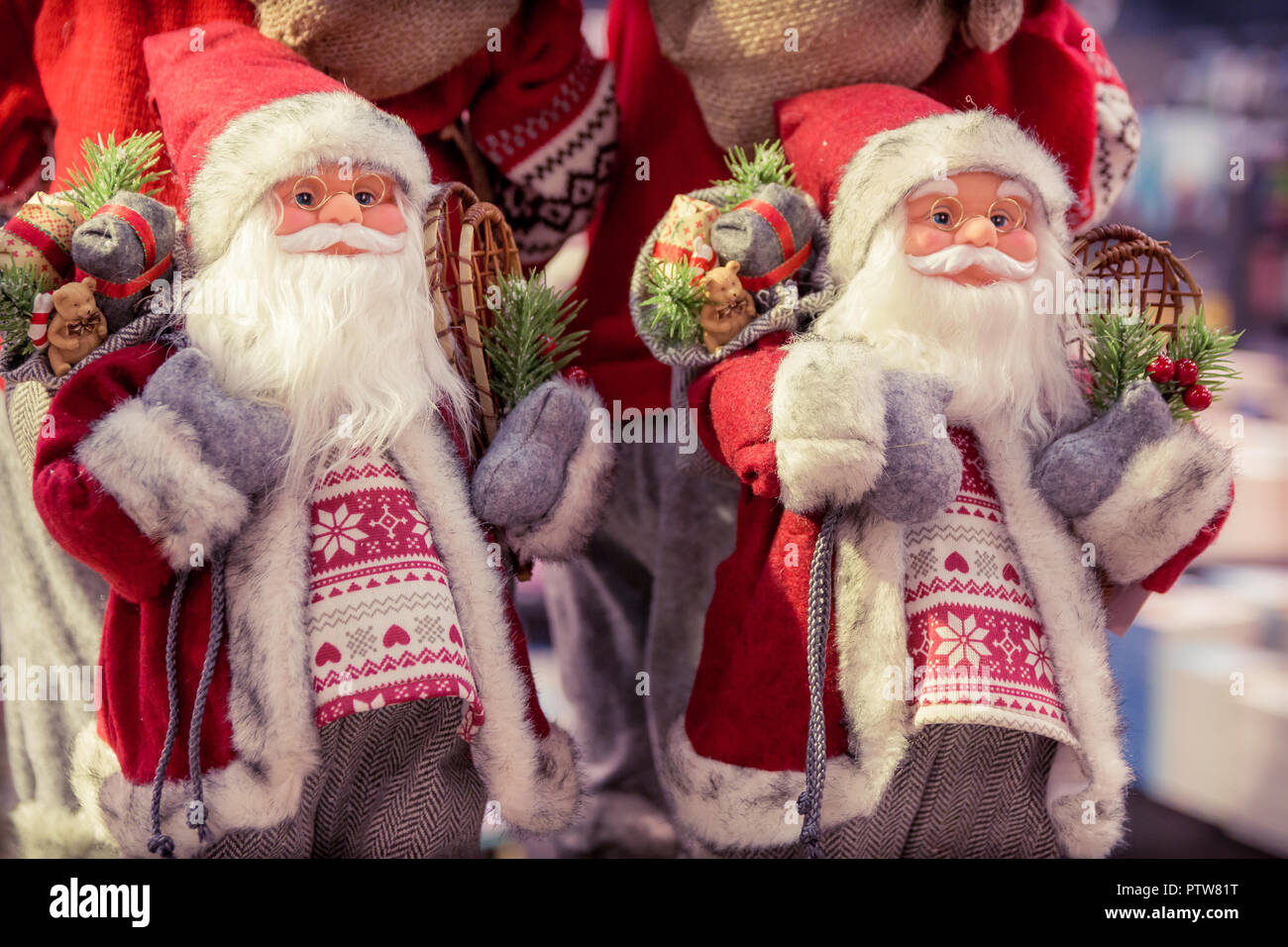 Christmas Decoration With Two Santa Claus Figurines Vintage Filter Effect
