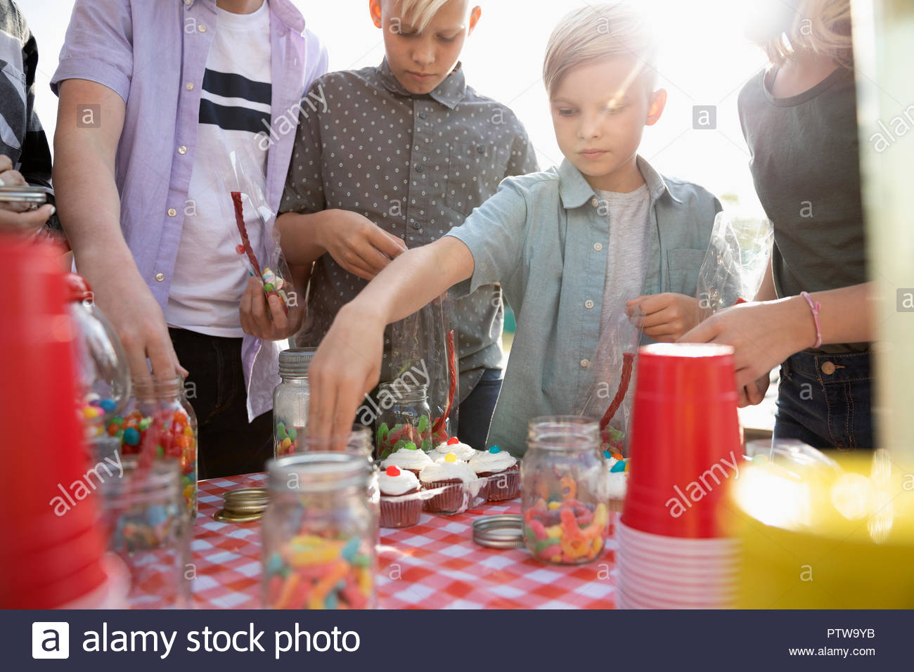Family at carnival sweets booth - Stock Image
