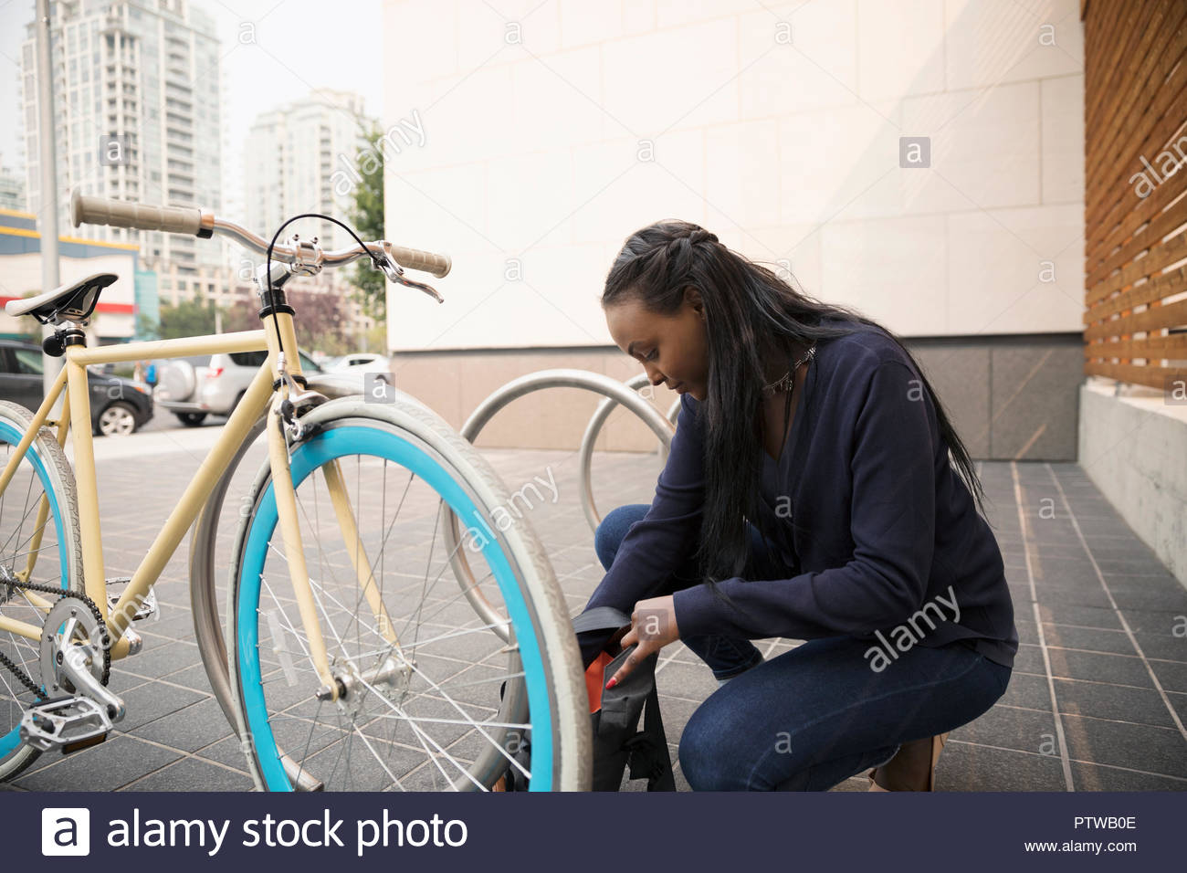 Businesswoman commuter with bicycle - Stock Image