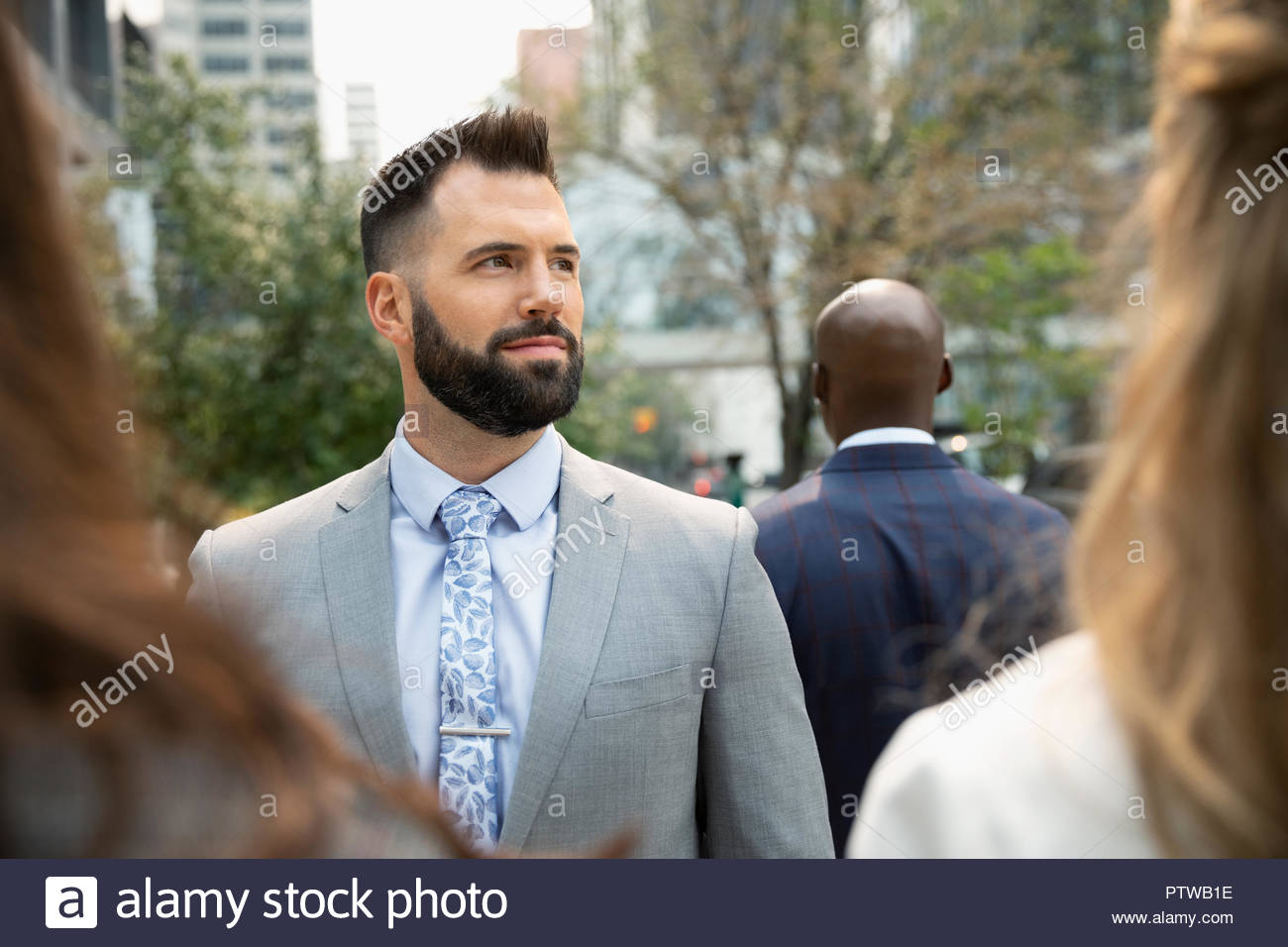 Portrait confident, ambitious businessman on urban sidewalk - Stock Image