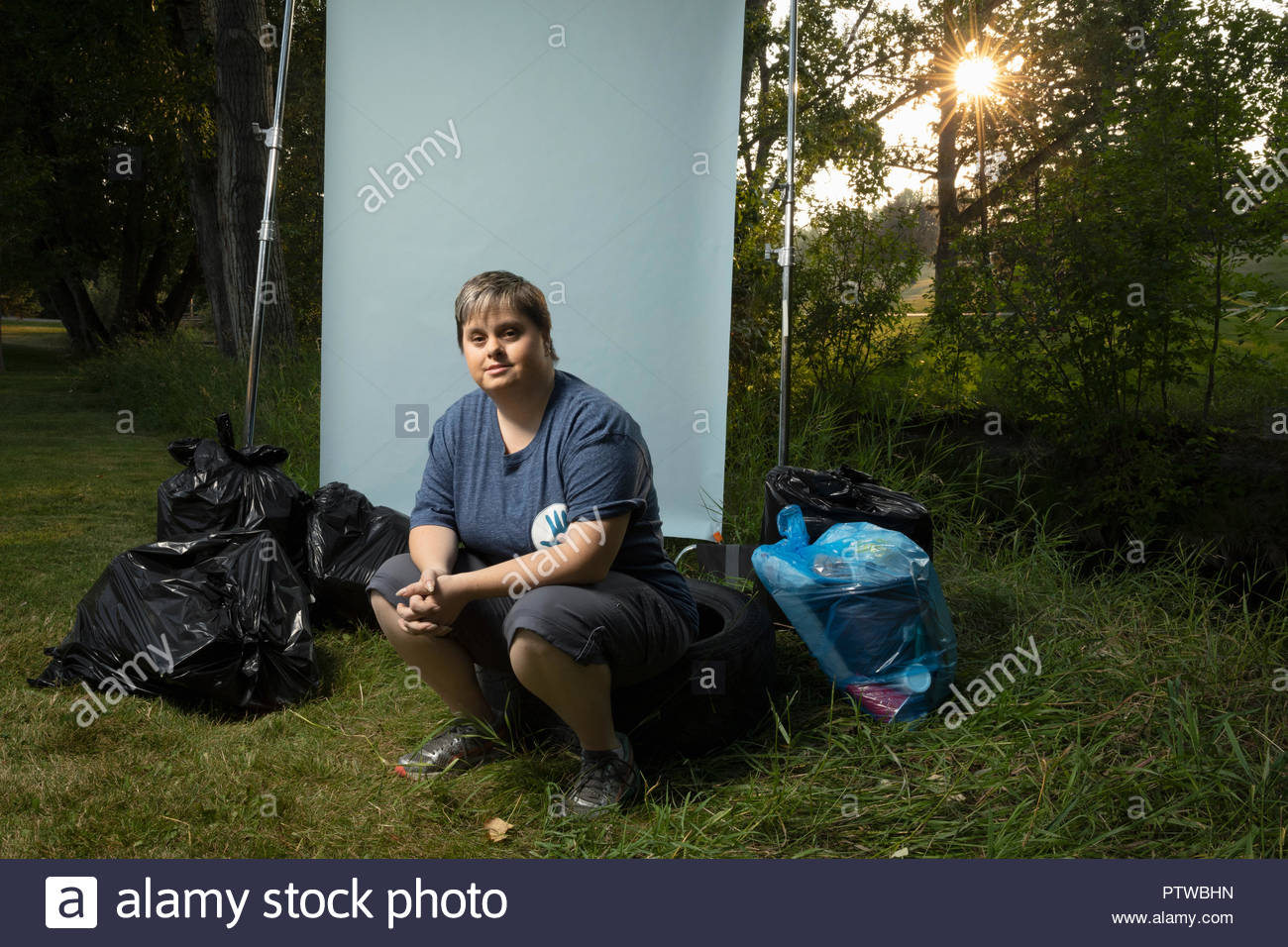 Portrait confident woman with down syndrome volunteering, cleaning