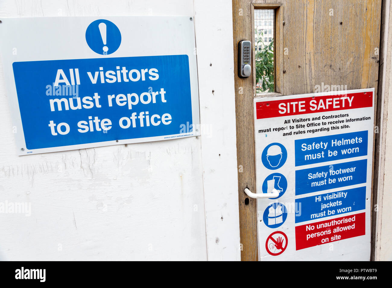 London England United Kingdom Great Britain Southwark under construction site office entrance safety rules guidelines hard hats helmets proper footwea - Stock Image