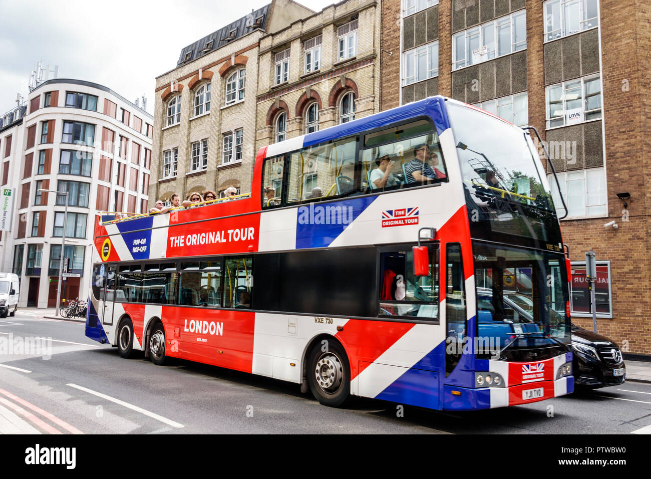 London England United Kingdom Great Britain Southwark open-top double-decker sightseeing bus passenger The Original Tour - Stock Image