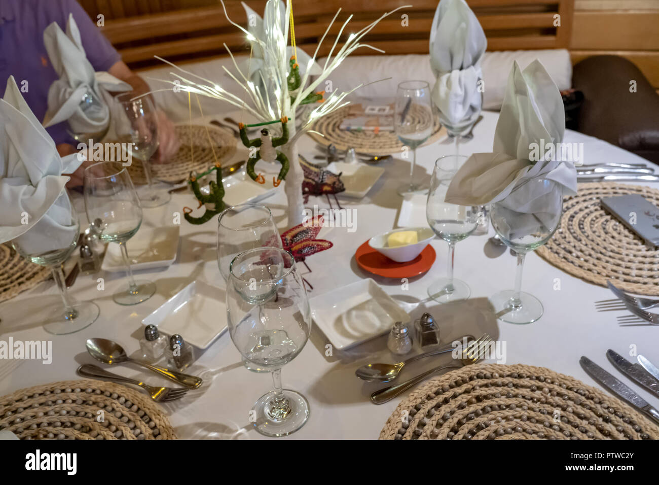 Peru, South America.  Table decorations with handmade sloths and butterflies on a tour boat. - Stock Image