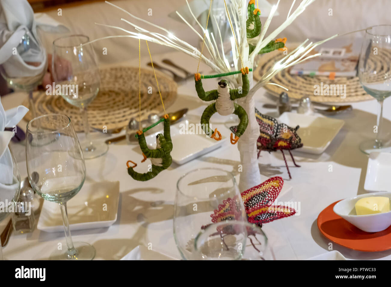 Peru, South America.  Table decorations with handmade sloths and butterflies on a tour boat. Stock Photo