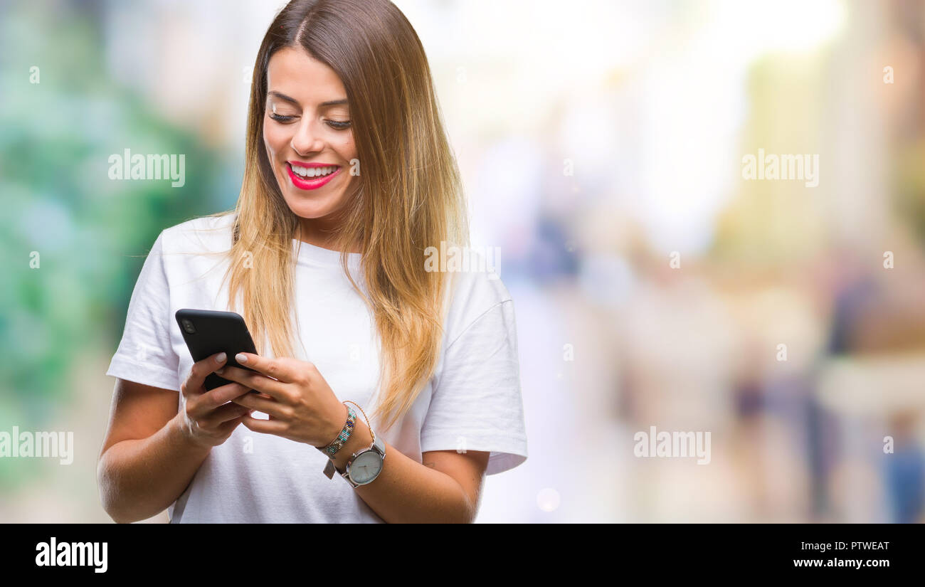 Beautiful young woman using smartphone over isolated background Stock Photo