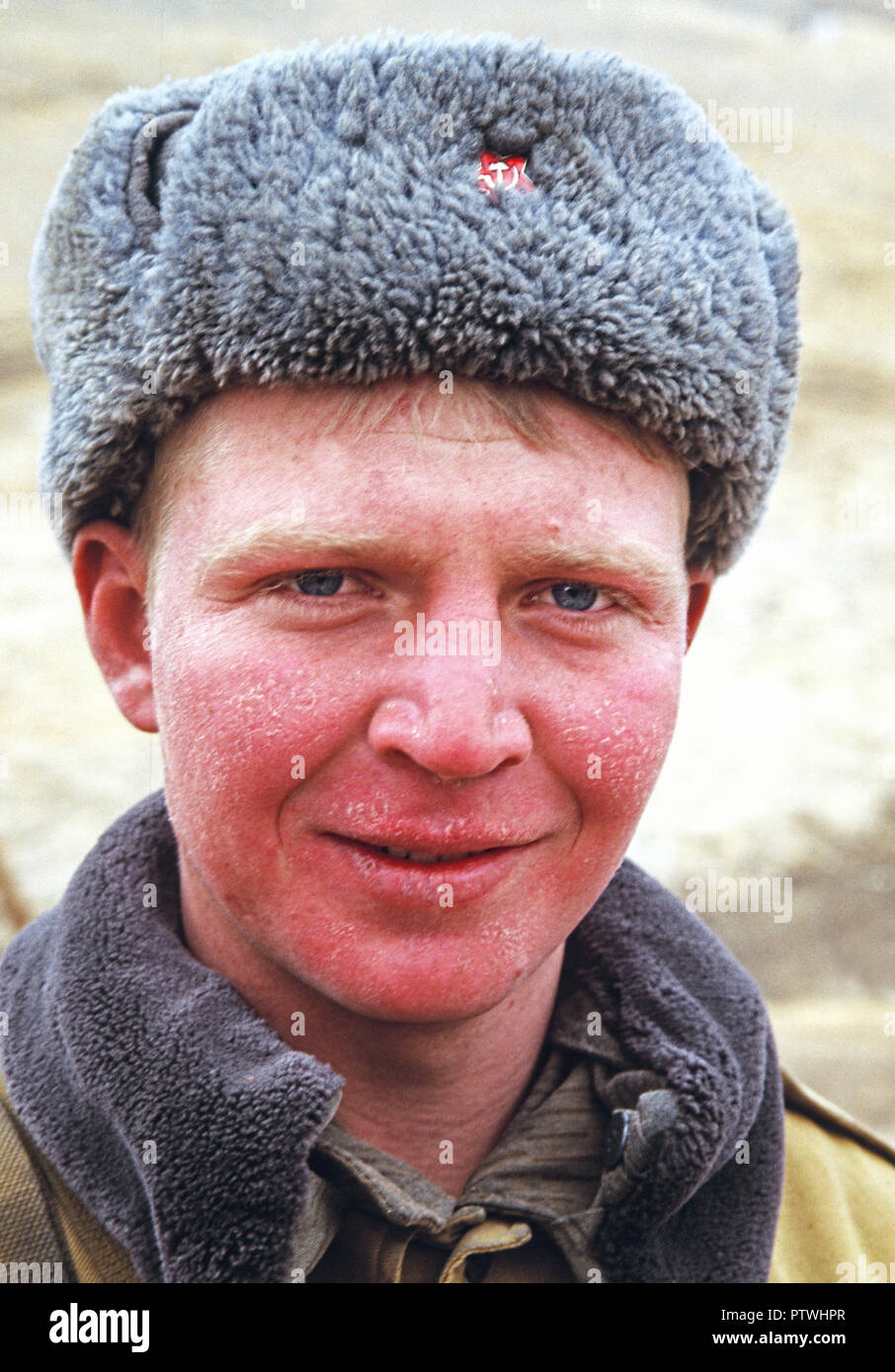 Russian soldier guard with frost bite on Kyrgyzstan border with China - Stock Image