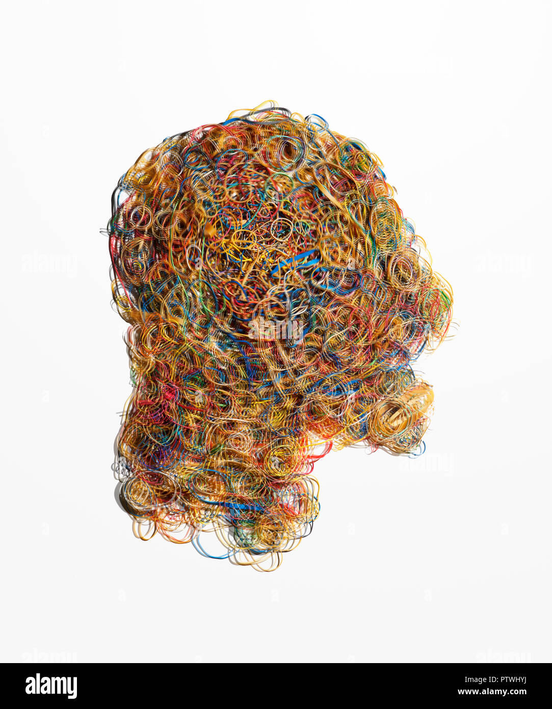 Shape of human head made from elastic rubber bands - Stock Image