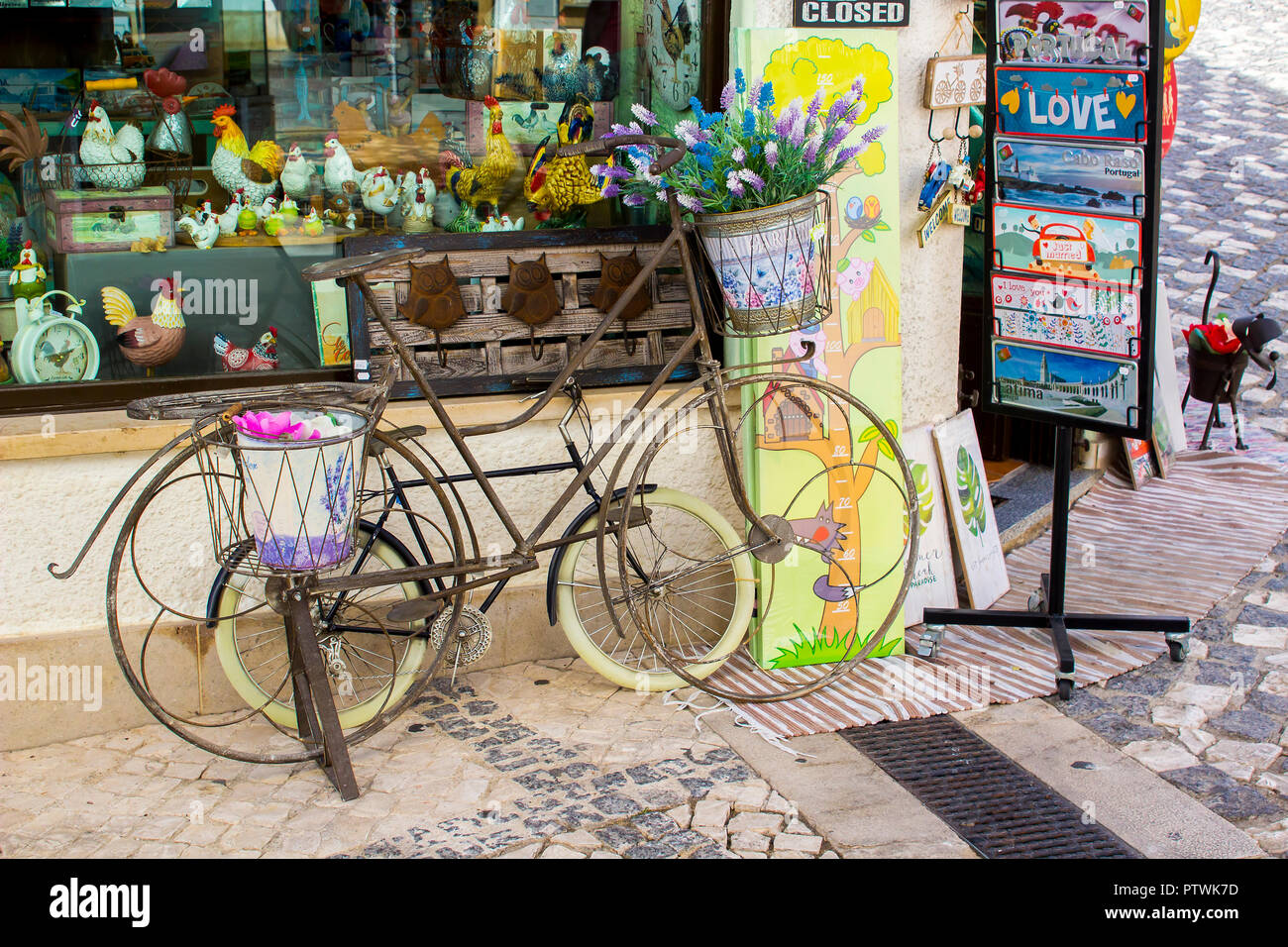 28 September 2018 Comical Ornamental bicycles for sale and on display outside a gift shop in Albuferia - Stock Image