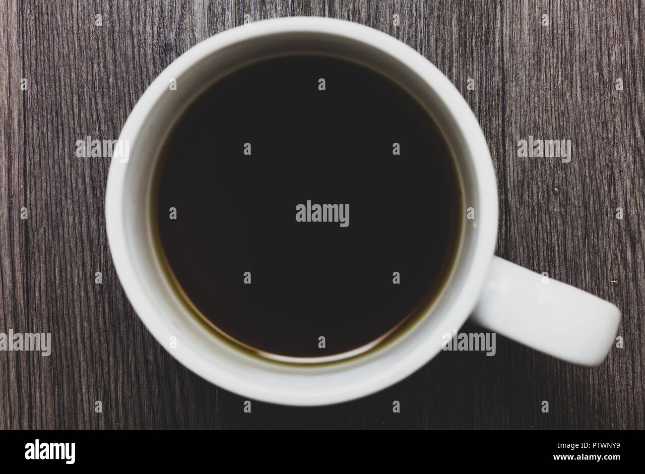 design business concept empty template copy space text for ad website isolated black coffee with coffee mug floating texts on gray black wooden desk PTWNY9