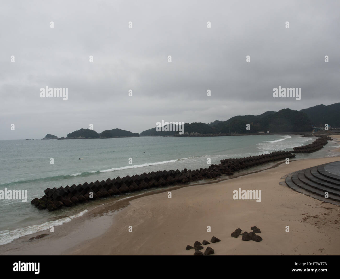 Tetrapod reefs on sandy beach with surfers and circe stairs, Shishikui,  Tokushima,  Shikoku, Japan - Stock Image