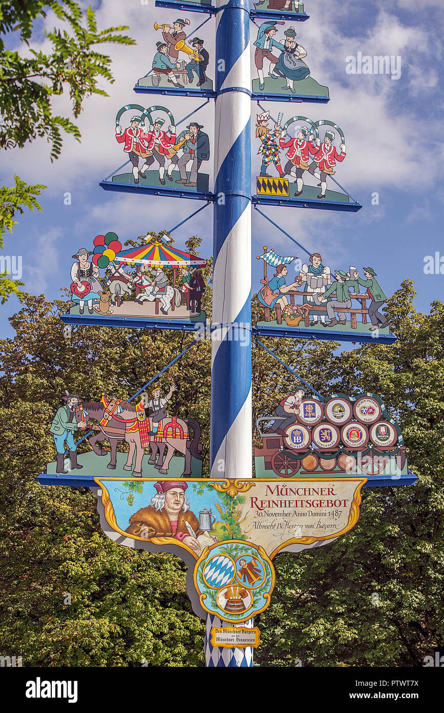 Close-up of the quite distinctive Maypole/Maibaum situated within the confines of Munich's Viktualienmarkt on a fine autumn day. - Stock Image