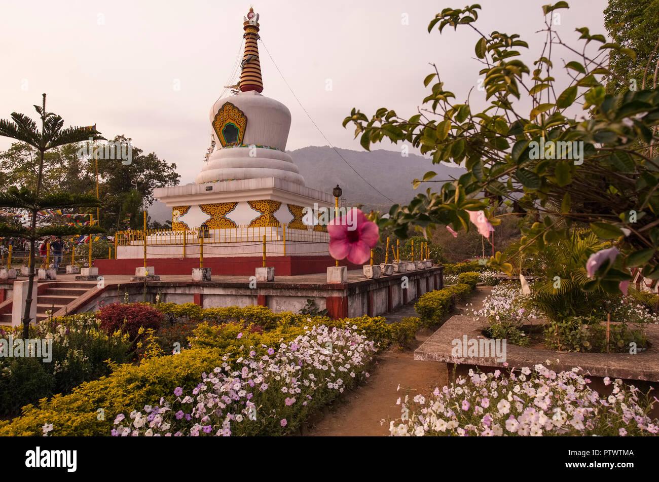 itanagar,buddhist gumpha,arunachal pradesh,in a flower garden,on top