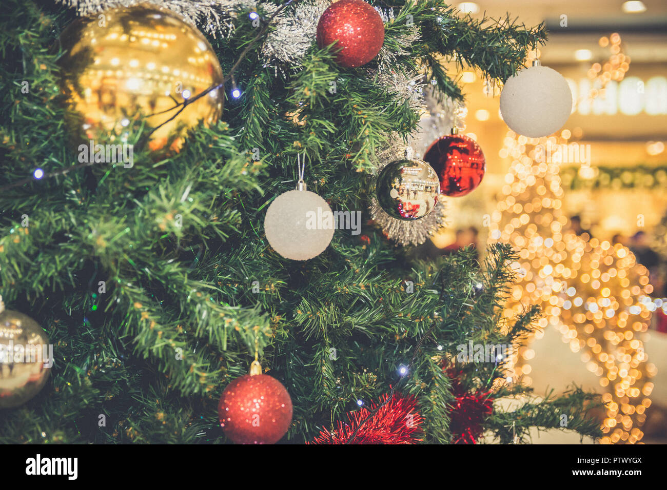 Decorated Christmas Tree With Baubles Tinsel And Lights Close Up Vintage Filter Effect Stock Photo Alamy
