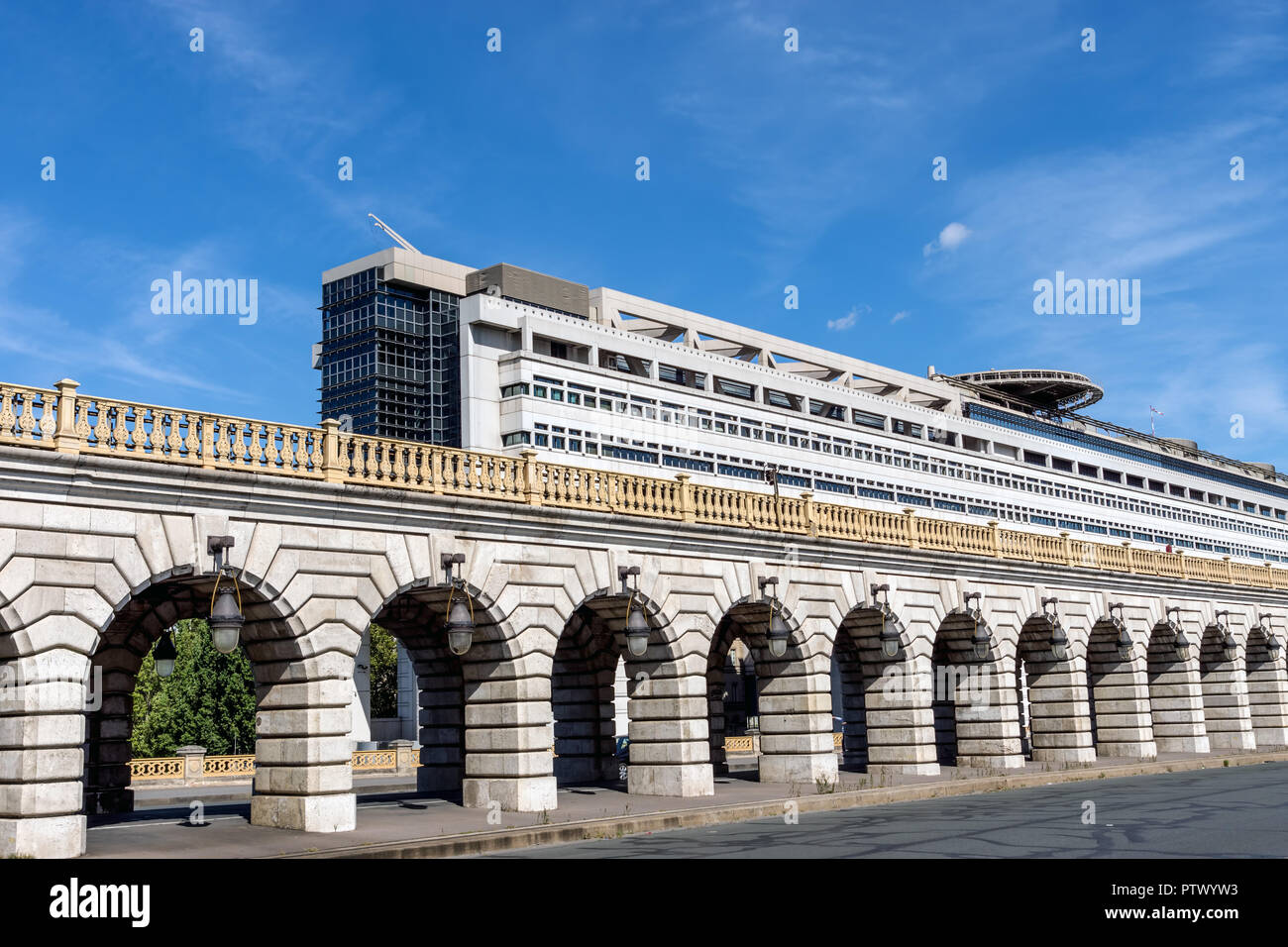 Bercy bridge and French Ministry for the Economy and Finance - Paris - Stock Image