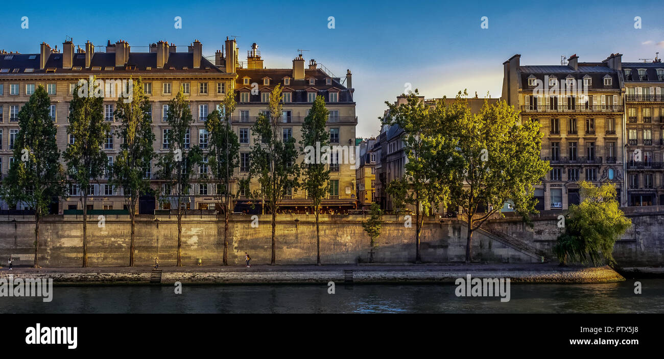 Looking across the River Seine in Paris to the Latin Quarter and Left Bank in the last of the evening sun light - Stock Image