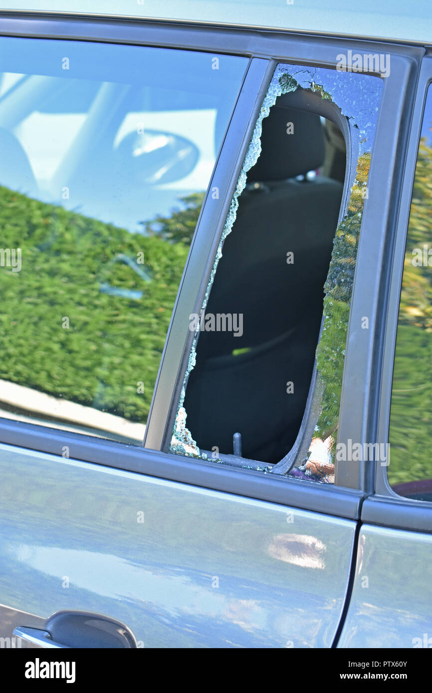 Smashed car window due to theft - Stock Image
