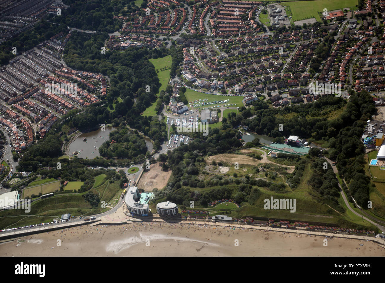 Scarborough North Bay developments - Peasholm, The Sands Apartments, Open Air Theatre, Alpamare, Indoor Pool, Mr Marvels - Stock Image