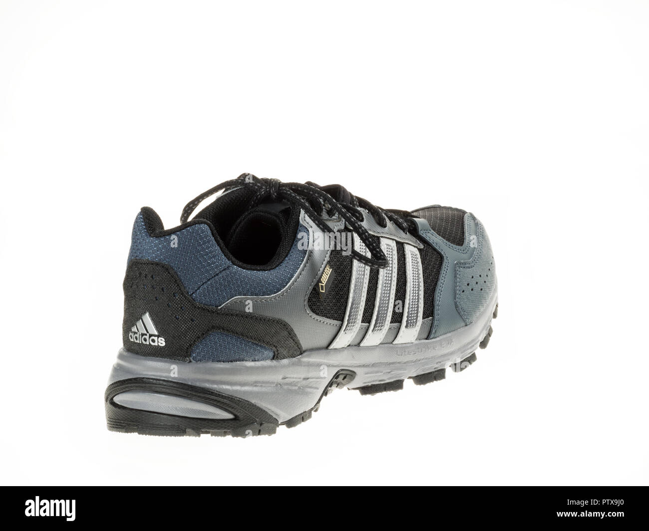 Istanbul, Turkey - January 29, 2014: New Adidas outdoor running shoes Taken at studio and isolated on white. Stock Photo