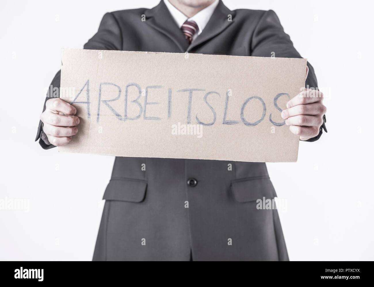 Mann haelt Pappe, 'Arbeitslos' (model-released) - Stock Image