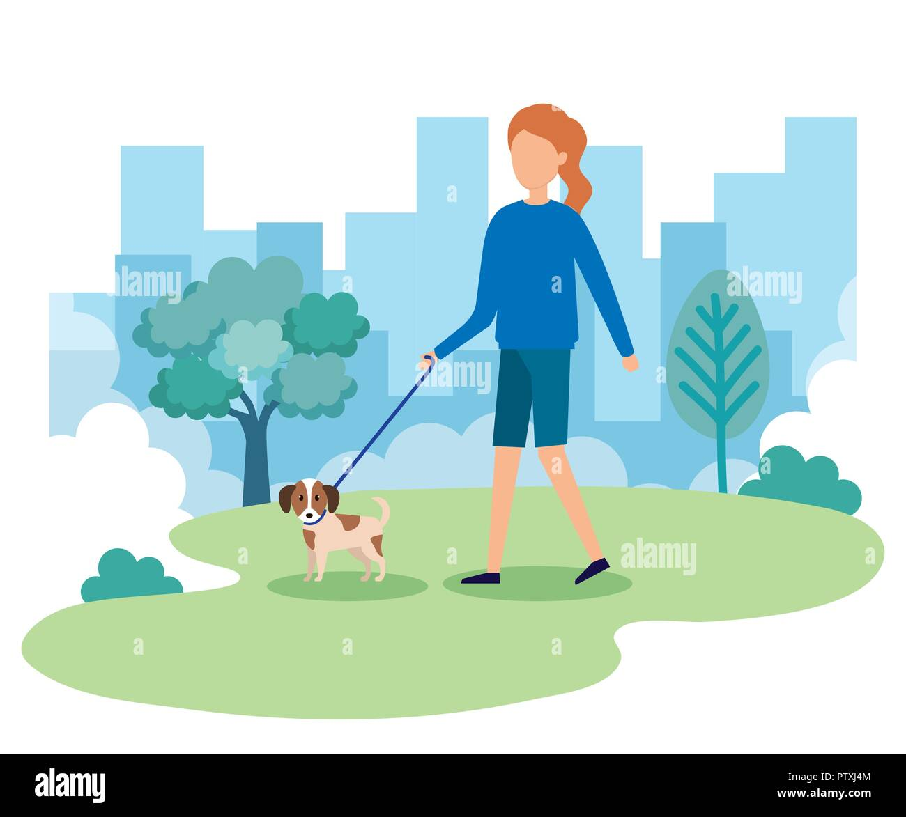 young woman with dog in the park - Stock Image
