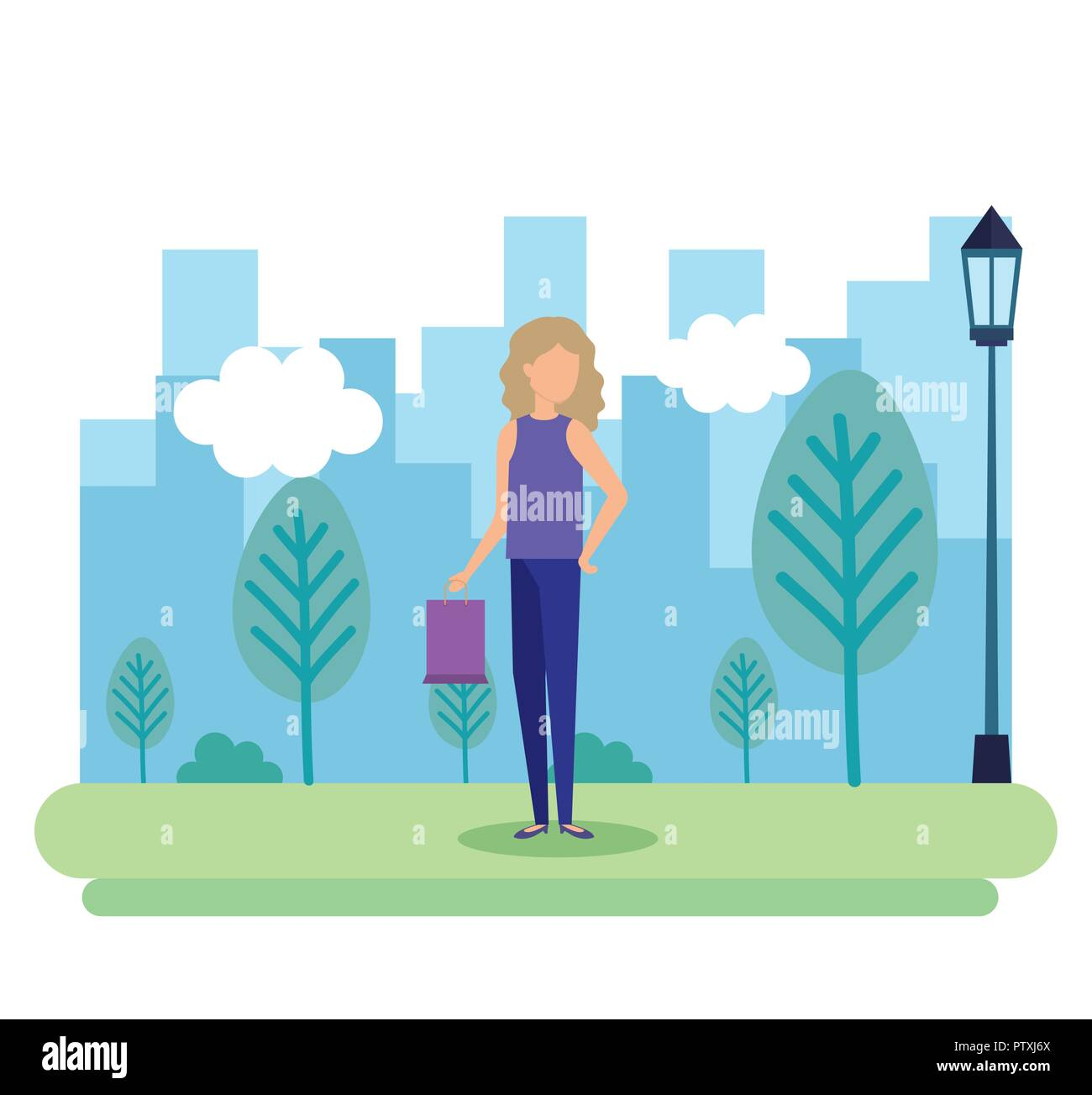 young woman with shopping bag in the park - Stock Image