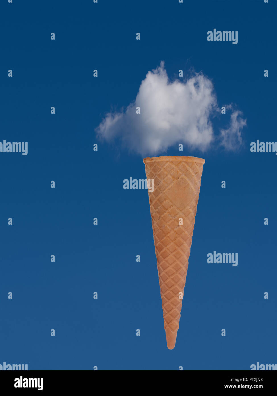 Ice cream cone with blue sky and cloud. Dream holiday, vacation concept. - Stock Image