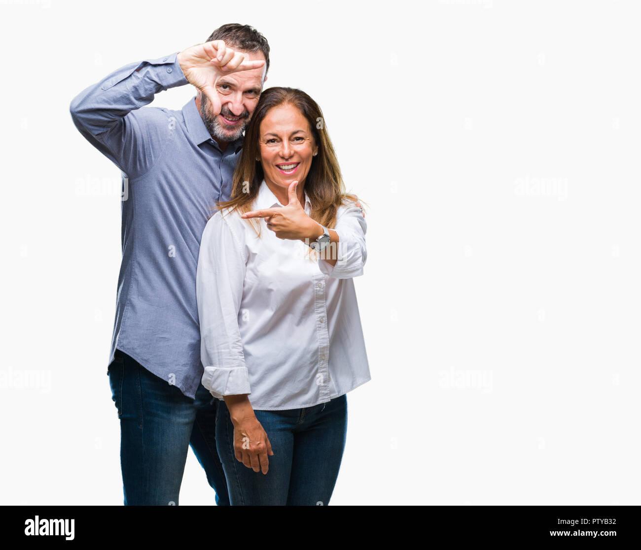Middle age hispanic business couple over isolated background smiling ...