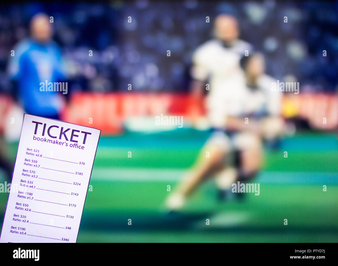 Bookmaker ticket on the background of the TV on which there is a sports game of cricket, sports betting, gambler - Stock Image